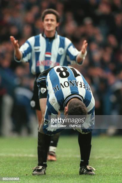 Sheffield Wednesday's Dejan Stefanovic holds his head in his hands in despair after missing an easy goal