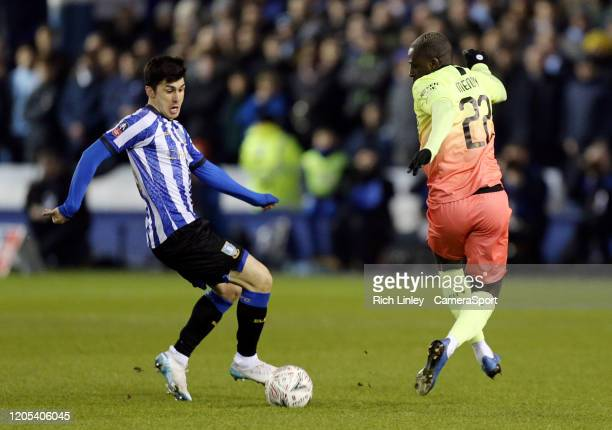 Sheffield Wednesday's Fernando Forestieri under pressure from Manchester City's Benjamin Mendy during the FA Cup Fifth Round match between Sheffield...