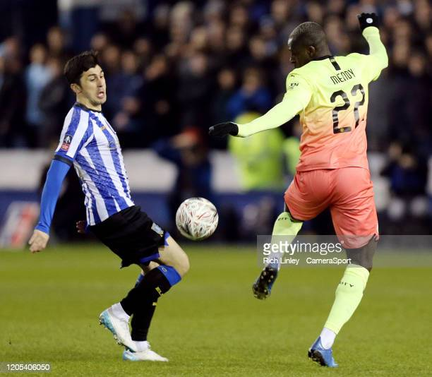 Sheffield Wednesday's Fernando Forestieri vies for possession with Manchester City's Benjamin Mendy during the FA Cup Fifth Round match between...