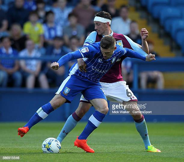 Sheffield Wednesday's Gary Hooper battles with Aston Villa's Tommy Elphick during the during the EFL Sky Bet Championship match between Sheffield...