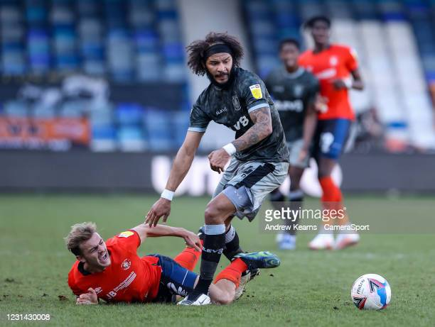 Sheffield Wednesday's Isaiah Brown competing with Luton Town's Kiernan Dewsbury-Hall during the Sky Bet Championship match between Luton Town and...