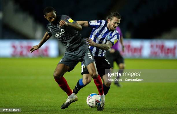 Sheffield Wednesday's Jack Marriott battles with Brentford's Ethan Pinnock during the Sky Bet Championship match between Sheffield Wednesday and...