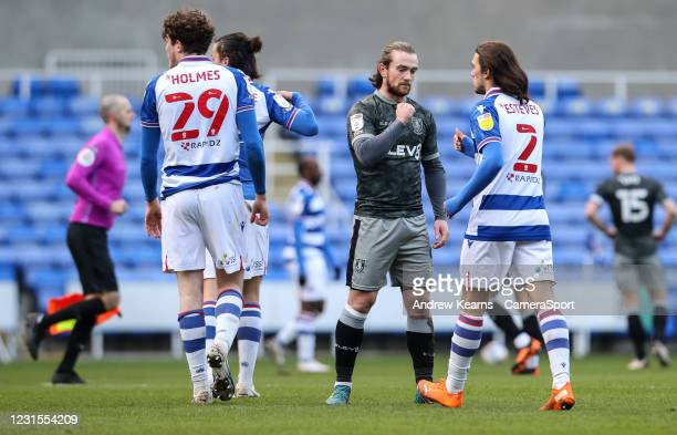 Sheffield Wednesday's Jack Marriott bumps fists with Reading's Tomas Esteves at the end of the match during the Sky Bet Championship match between...