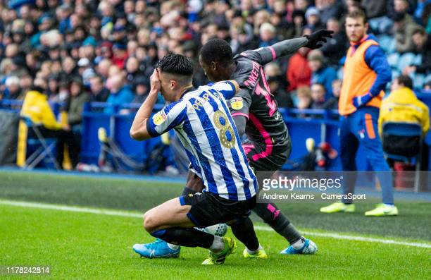Sheffield Wednesday's Joey Pelupessy holds his face after a challenge from Leeds United's Edward Nketiah during the Sky Bet Championship match...