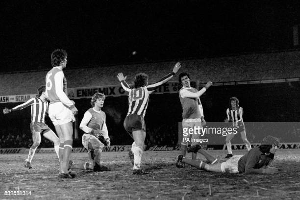 Sheffield Wednesday's John Lowey celebrates his goal to the disappointment of Arsenal's David O'Leary Willie Young Frank Stapleton and Pat Jennings