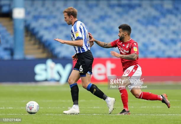 Sheffield Wednesday's Jordan Rhodes under pressure from Nottingham Forest's Tiago Silva during the Sky Bet Championship match between Sheffield...