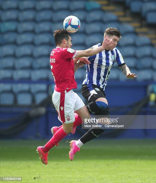 Sheffield Wednesday's Josh Windass jumps with Nottingham Forest's Yuri Ribeiro during the Sky Bet Championship match between Sheffield Wednesday and...