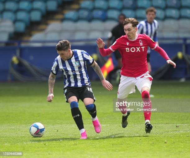 Sheffield Wednesday's Josh Windass Nottingham Forest's James Garner during the Sky Bet Championship match between Sheffield Wednesday and Nottingham...