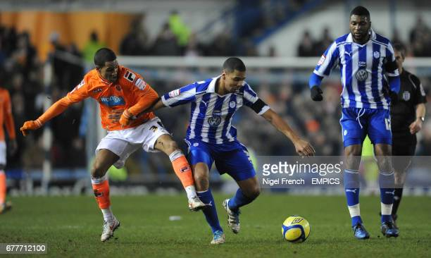 Sheffield Wednesday's Julian Bennett and Blackpool's Thomas Ince battle for the ball