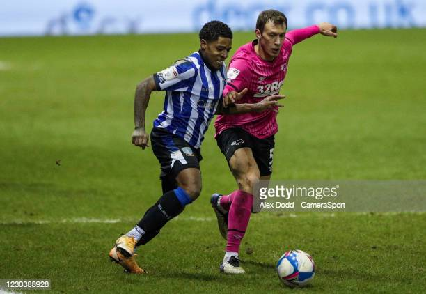 Sheffield Wednesday's Kadeem Harris battles with Derby County's Krystian Bielik during the Sky Bet Championship match between Sheffield Wednesday and...