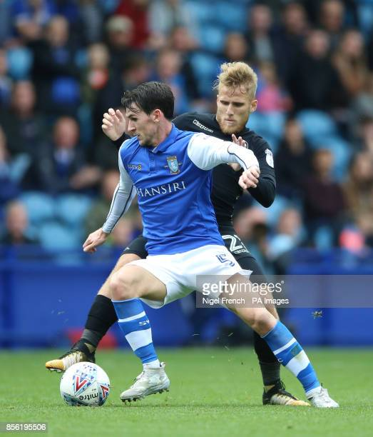 Sheffield Wednesday's Kieran Lee and Leeds United's Samuel Saiz battle for the ball during the Sky Bet Championship match at Hillsborough Sheffield
