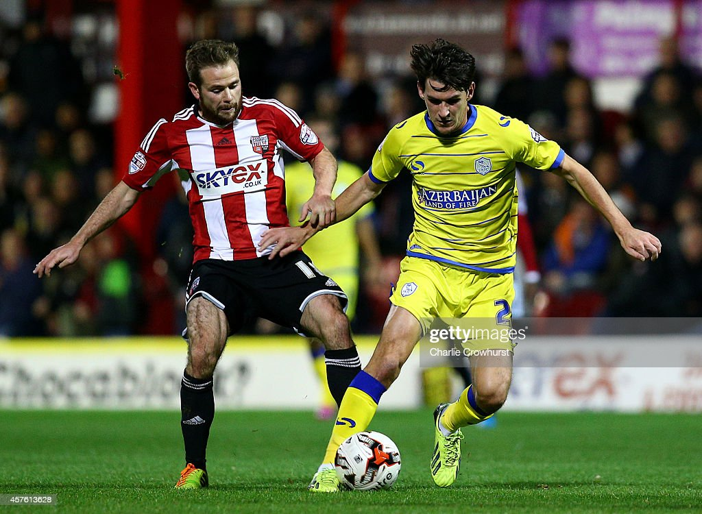 Sheffield Wednesday's Kieran Lee is fouled by Alan Judge of Brentford during the Sky Bet Championship match between Brentford and Sheffield Wednesday at Griffin Park on October 21, 2014 in Brentford, England.