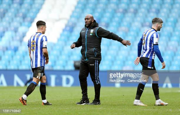 Sheffield Wednesday's manager Darren Moore consoles his players at the final whistle during the Sky Bet Championship match between Sheffield...