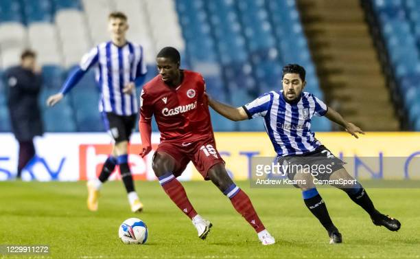 Sheffield Wednesday's Massimo Luongo competing with Reading's Lucas Joao during the Sky Bet Championship match between Sheffield Wednesday and...