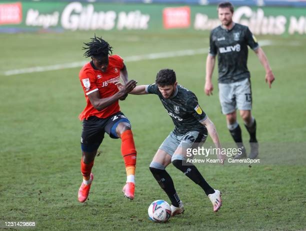 Sheffield Wednesday's Matt Penney competing with Luton Town's Elijah Adebayo during the Sky Bet Championship match between Luton Town and Sheffield...