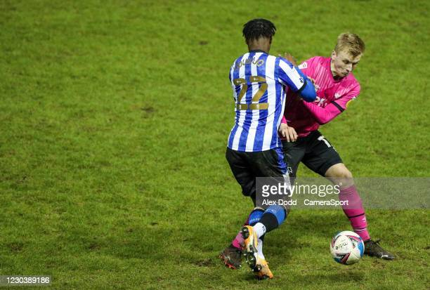 Sheffield Wednesday's Moses Odubajo battles with Derby County's Louie Sibley during the Sky Bet Championship match between Sheffield Wednesday and...