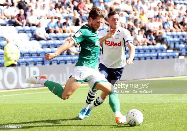 Sheffield Wednesday's Sam Hutchinson clears under pressure from Preston North End's Alan Browne during the Sky Bet Championship match between Preston...