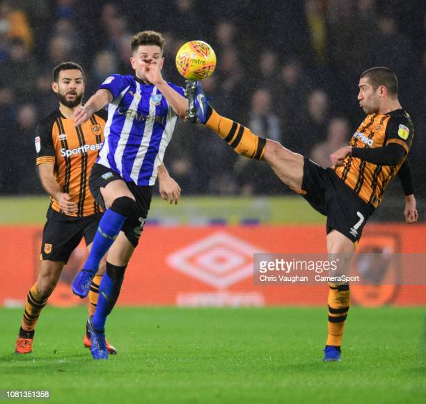 Sheffield Wednesday's Sam Hutchinson vies for possession with Hull City's Evandro Goebel during the Sky Bet Championship match between Hull City and...