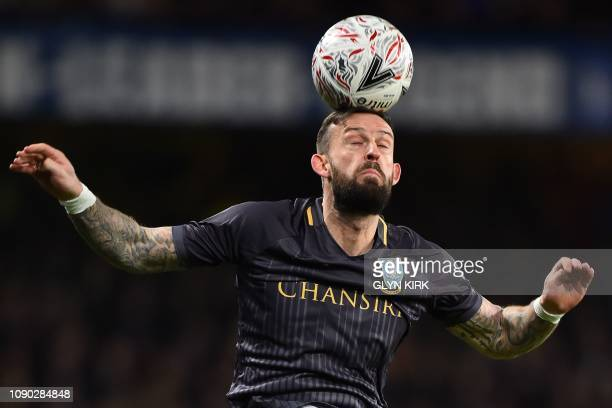 Sheffield Wednesday's Scottish striker Steven Fletcher heads the ball during the English FA Cup fourth round football match between Chelsea and...
