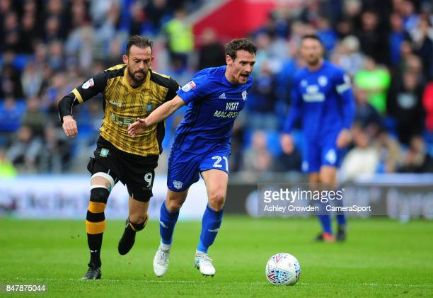 Sheffield Wednesday's Steven Fletcher vies for possession with Cardiff City's Craig Bryson during the Sky Bet Championship match between Cardiff City...