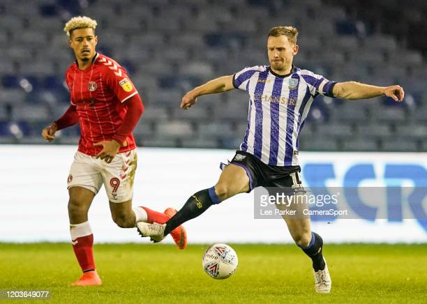 Sheffield Wednesday's Tom Lees controls the ball with Charlton Athletic's Lyle Taylor close by during the Sky Bet Championship match between...