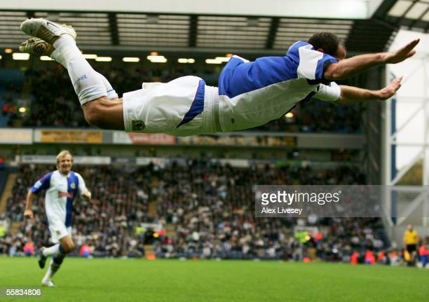 Shefki Kuqi of Blackburn Rovers celebrates with his trade mark dive after scoring the first goal during the Barclays Premiership match between...