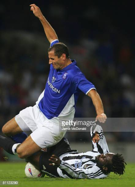Shefki Kuqi of Ipswich is tackled by Olivier Bernard of Newcastle during the preseason friendly match between Ipswich Town v Newcastle United at...