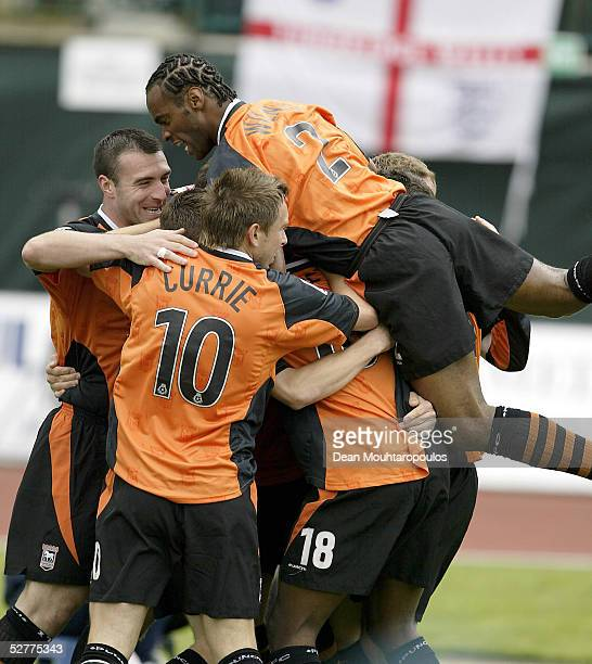 Shefki Kuqi of Ipswich Town is mobbed after scoring the opening goal of the game during the CocaCola Football league Championship match between...
