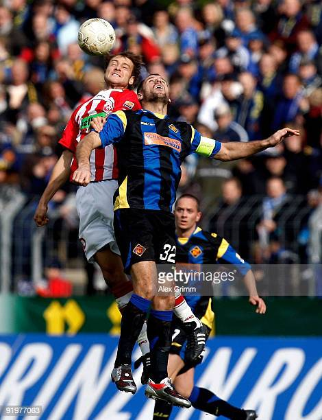 Shefki Kuqi of Koblenz jumps for a header with Nils Doering of Ahlen during the Second Bundesliga match between TuS Koblenz and RotWeiss Ahlen at the...
