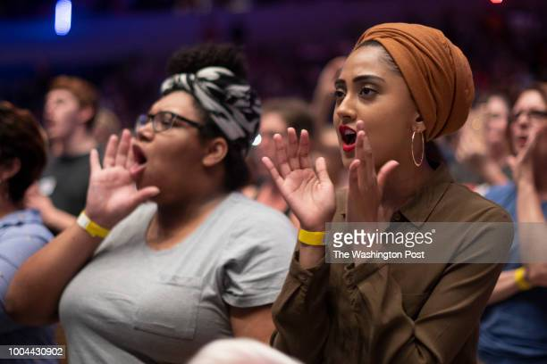 Shegufta Huma react to Sen Bernie Sanders during a campagn rally in Wichita Kansas on July 20 2018 Sanders appeared at a rally with rising stars in...
