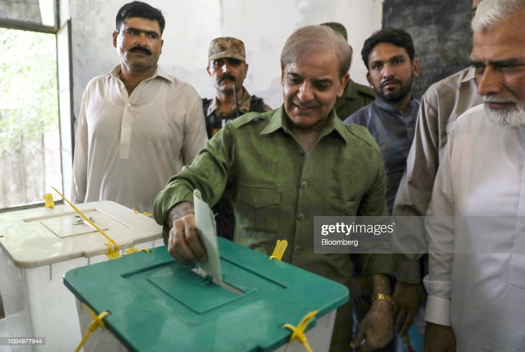 Shehbaz Sharif president of the Pakistan Muslim LeagueNawaz casts his ballot at a polling station in Lahore Pakistan on Wednesday July 25 2018...