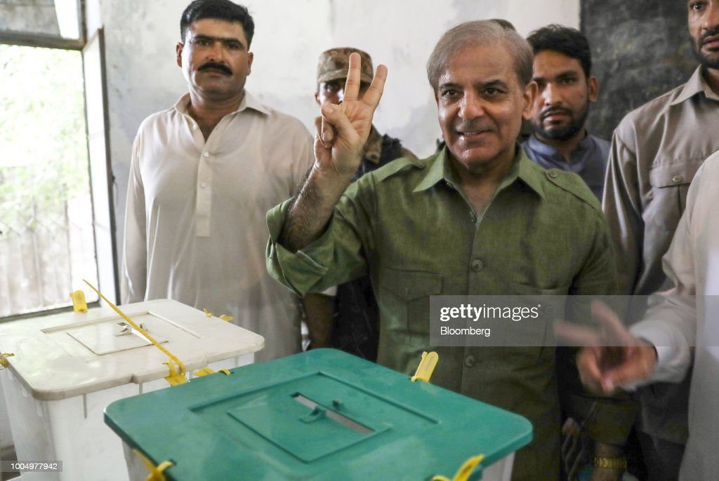 Shehbaz Sharif president of the Pakistan Muslim LeagueNawaz center gestures after casting his ballot at a polling station in Lahore Pakistan on...