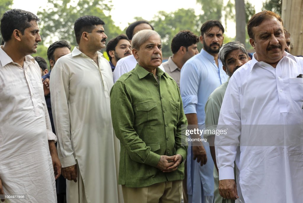 Shehbaz Sharif president of the Pakistan Muslim LeagueNawaz center waits in line to cast his vote at a polling station in Lahore Pakistan on...
