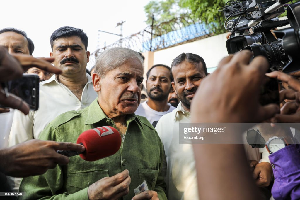 Shehbaz Sharif president of the Pakistan Muslim LeagueNawaz center speaks with members of the media outside a polling station in Lahore Pakistan on...