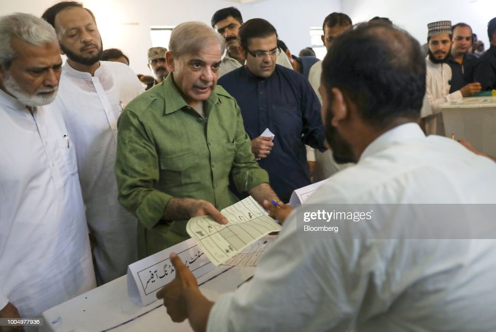Shehbaz Sharif president of the Pakistan Muslim LeagueNawaz receives his ballot at a polling station in Lahore Pakistan on Wednesday July 25 2018...