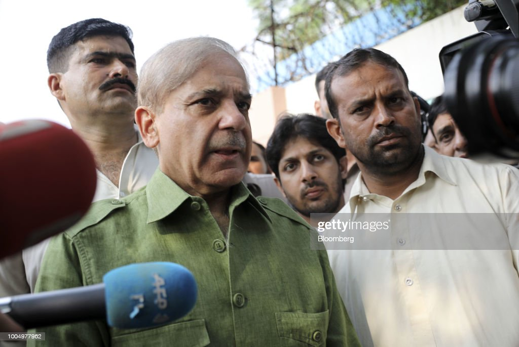 Shehbaz Sharif president of the Pakistan Muslim LeagueNawaz speaks with members of the media outside a polling station in Lahore Pakistan on...