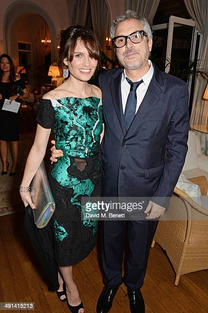 Sheherazade Goldsmith and Alfonso Cuaron attends the annual Charles Finch Filmmakers Dinner during the 67th Cannes Film Festival at Hotel du...
