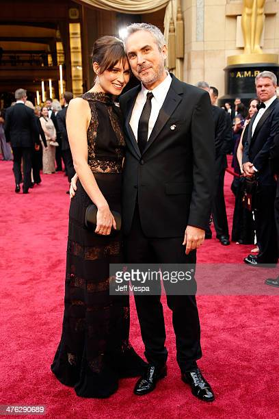 Sheherazade Goldsmith and Director Alfonso Cuaron attend the 86th Oscars held at Hollywood Highland Center on March 2 2014 in Hollywood California