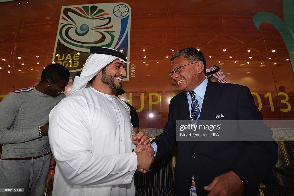 Sheiek Abdullah Bin Mohamed Bin Khalid Alinhayah welcomes Adnan Al Agendi, LOC general coordinator during the round of 16 match between Nigeria and Iran at Khalifa Bin Zayed Stadium on October 29, 2013 in Al Ain, United Arab Emirates.