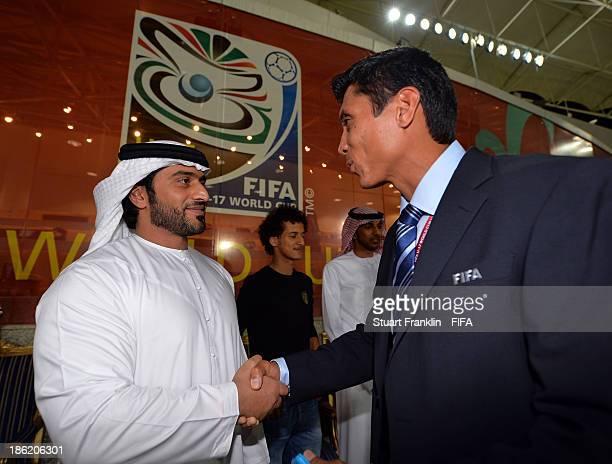 Sheiek Abdullah Bin Mohamed Bin Khalid Alinhayah welcomes Eddie Morales of FIFA during the round of 16 match between Nigeria and Iran at Khalifa Bin...