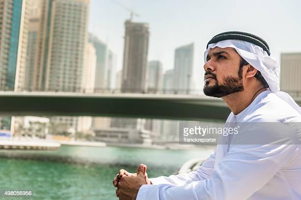 sheik pensive on the Dubai Marina city