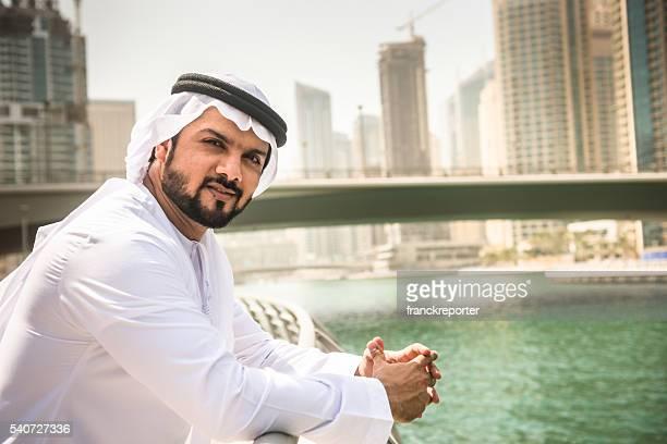 sheik standing pensive on dubai marina