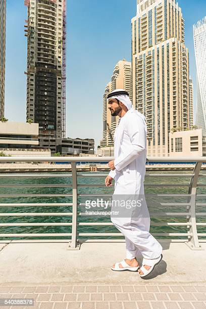 sheik twalking on the marina - side view stock pictures, royalty-free photos & images