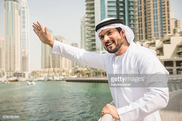 sheik waving hand in dubai marina