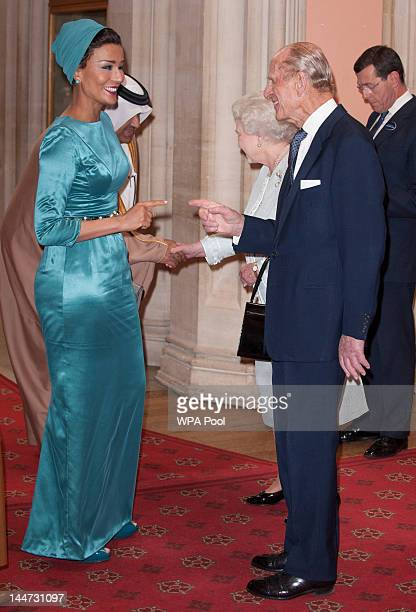 Sheika Mozah bint Nasser AlMissned of Qatar is greeted by Queen Elizabeth II and Prince Phillip Duke of Edinburgh at a lunch For Sovereign Monarchs...