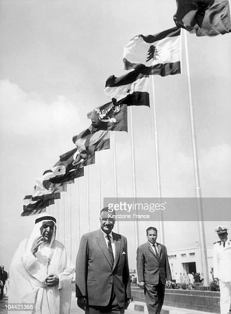 Sheikh Abdullah Al Salem Al Sabah The Kuwait Ruler Accompanied By President Nasser Walking Out Of The Airport With The Flags Of The 13 Arab States...