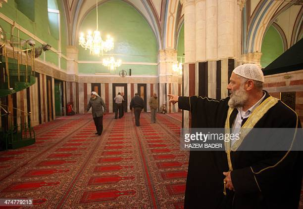 Sheikh Adel Idriss stands in the Ibrahimi Mosque on February 24 2014 in the southern West Bank city of Hebron On February 25 Israeli settler Baruch...