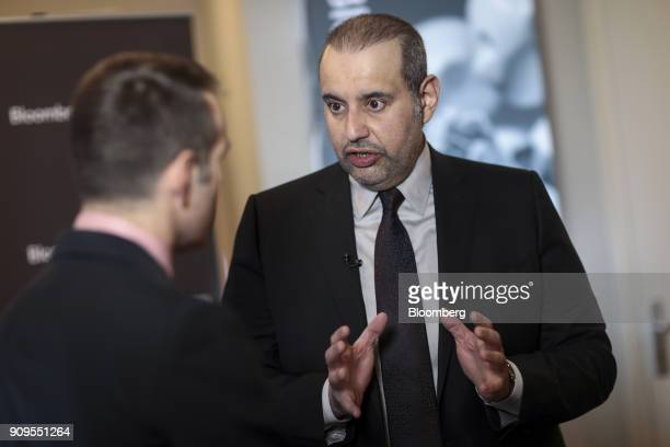 Sheikh Ahmed Bin Jassim Al Thani Qatar's economy and commerce minister speaks to an attendee on day two of the World Economic Forum in Davos...