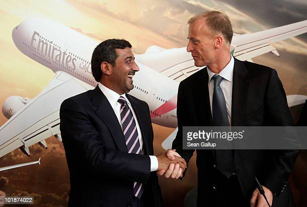 Sheikh Ahmed bin Saeed Al Maktoum Chairman of Emirates airline and Thomas Enders CEO of European aircraft manufacturer Airbus shake hands after...
