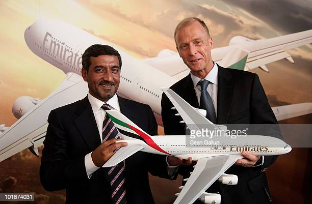 Sheikh Ahmed bin Saeed Al Maktoum Chairman of Emirates airline and Thomas Enders CEO of European aircraft manufacturer Airbus pose for photographers...